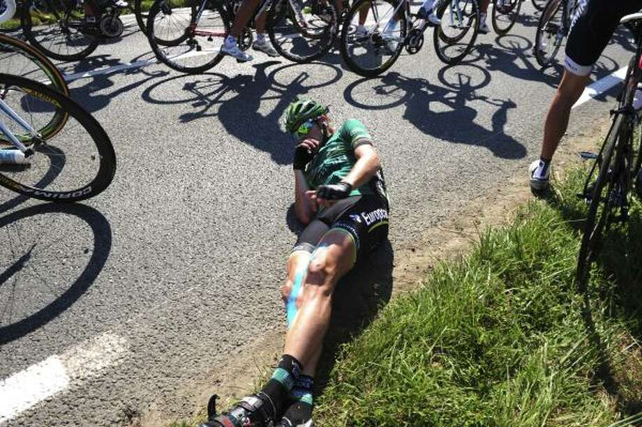 Vincent Jerome of France is seen on the ground after a crash in the last 10 kilometers of the first stage of the Tour de France. Photo: Stephane Mantay, Associated Press