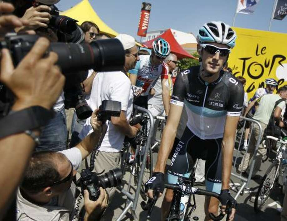 Photographers crowd around Andy Schleck of Luxembourg prior to the first stage of the Tour de France. Photo: Laurent Cipriani, Associated Press