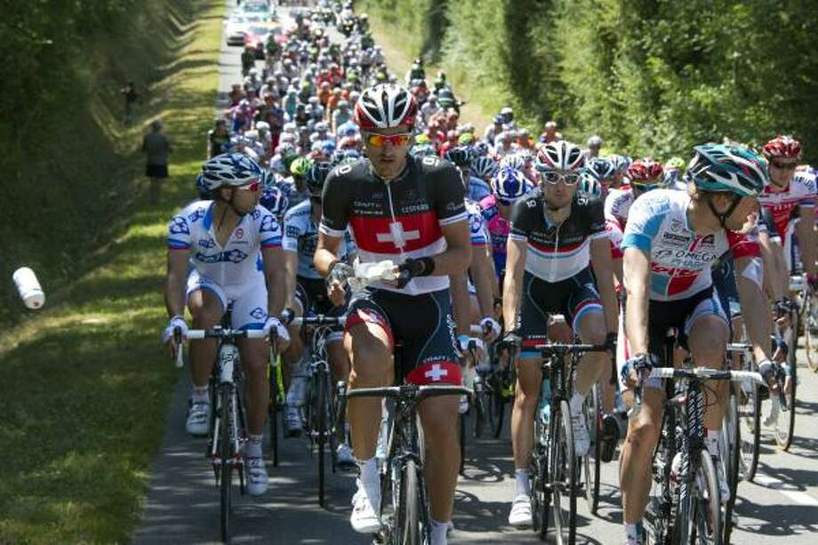 Switzerland's four-time world champion Fabian Cancellara (2ndL) rides in the pack. Photo: PASCAL PAVANI, Getty
