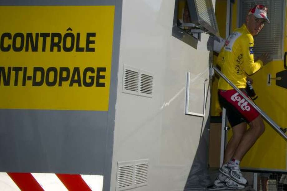 Yellow jersey of Overall leader, Belgium's Philippe Gilbert, leaves the anti-doping control bus at the end of the 191,5 km first stage. Photo: PASCAL PAVANI, Getty