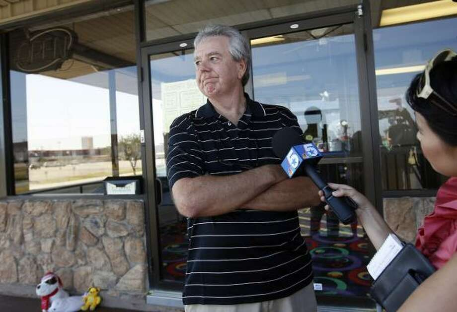 Walt Hedrick, owner of Forum Roller World, speaks with reporters Sunday after the shooting rampage. Photo: Sonya N. Hebert, Associated Press