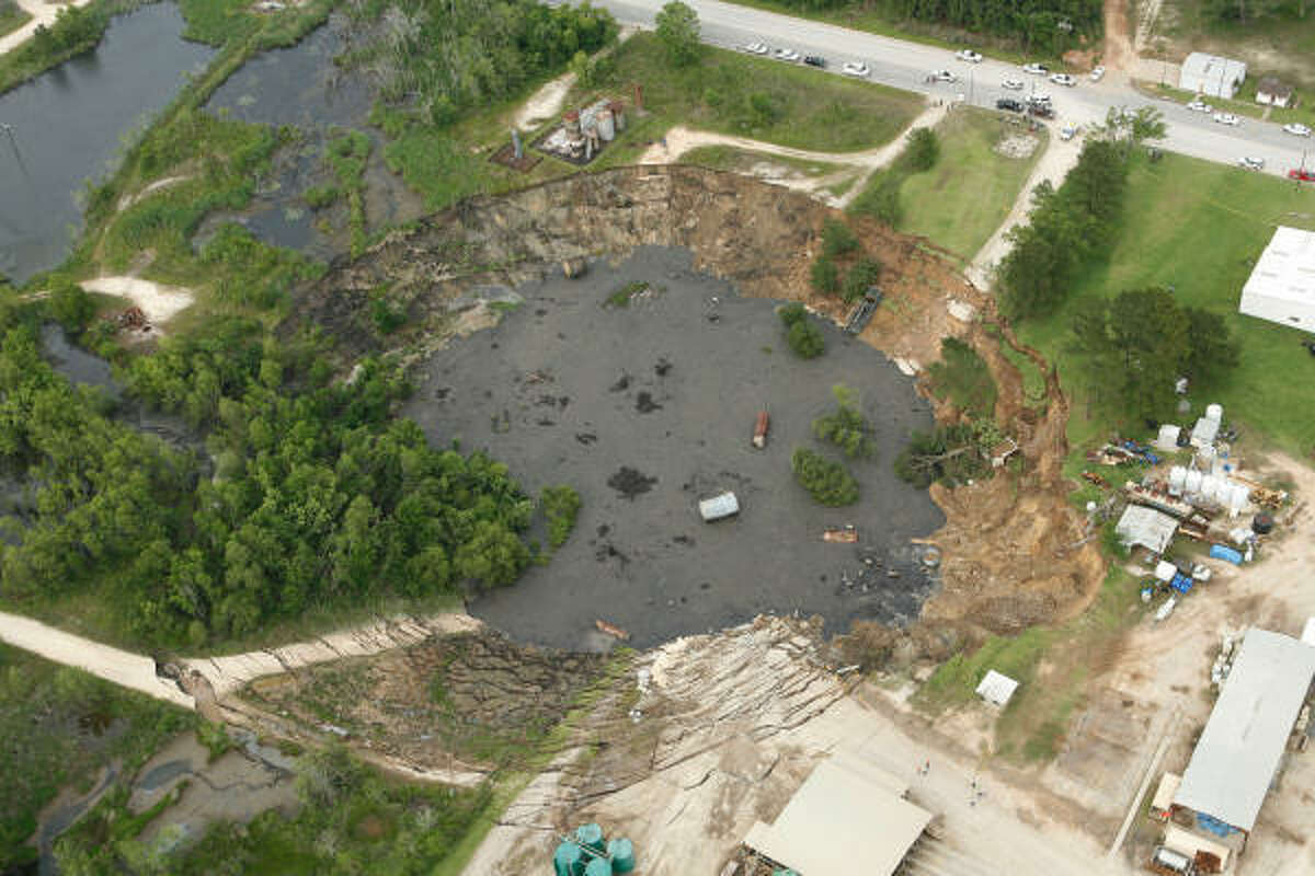 A massive sinkhole near Daisetta, Texas is seen Wednesday afternoon, May 7, 2008. The sinkhole swallowed up oil field equipment and some vehicles in southeast Texas and continued to grow.