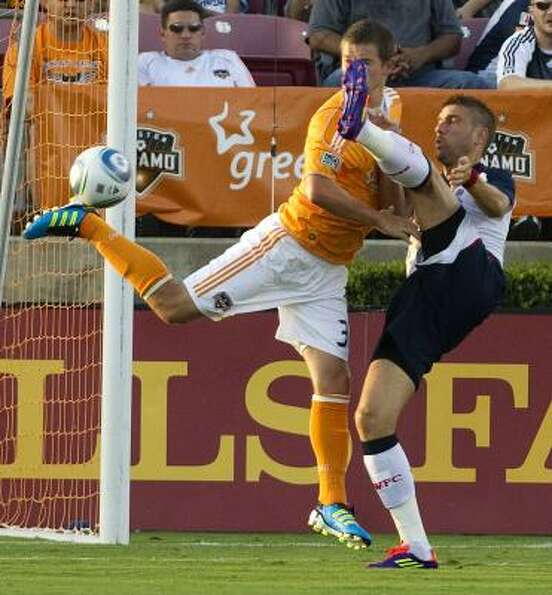 Dynamo defender Bobby Boswell, left, and Bolton striker Ivan Klasnic, right, fight for the ball near