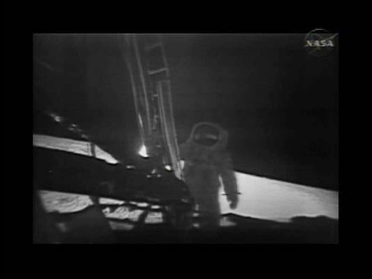 This photo, from NASA TV, shows one of the Apollo 11 astronauts on the lunar surface after landing from a new digitally refurbished version of the original moon landing video unveiled in Washington Thursday, July 16, 2009.