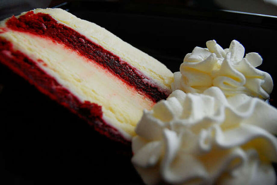"Cheesecake Factory Ultimate Red Velvet Cake Cheesecake:  Restaurant's description: ""Moist layers of Red Velvet Cake and our Original Cheesecake covered with our special Cheesecake Factory cream cheese frosting."" Nutritional breakdown: 1,540 calories; 59 grams of saturated fat CSPI's analysis: The equivalent of a Pizza Hut Personal Pan Pepperoni Pizza plus two Quarter Pounders with cheese (plus an added day's worth of saturated fat) Photo: Flickr"