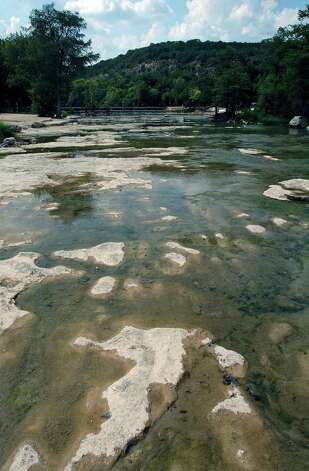 The Guadalupe River near Hueco Falls is now a collection of shallow pools. Photo: TOM REEL, SAN ANTONIO EXPRESS-NEWS / SAN ANTONIO EXPRESS-NEWS