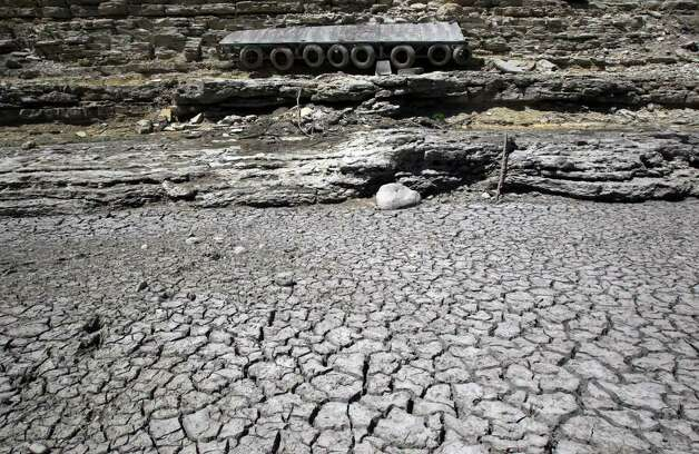 A dock hangs on a limestone cliff that once floated in the current of the Medina River south of Pipe Creek, Texas, and north of Medina Lake. Real estate in the area has been affected by the state's scorching drought this summer. Photo: JOHN DAVENPORT, SAN ANTONIO EXPRESS-NEWS / SAN ANTONIO EXPRESS-NEWS (Photo can be sold to the public)
