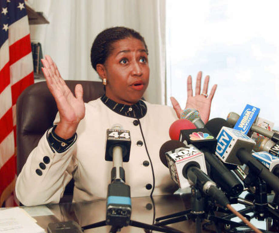 ** ADVANCE FOR MONDAY, OCT. 27 AND THEREAFTER -- FILE ** Sen. Carol Moseley-Braun, D-Ill., talks to reporters in her Chicago office in this Aug. 20, 1996 file photo to discuss her meeting with Gen. Sani Abacha, the military dictator of Nigeria, during a private visit to Nigeria. Braun doesn't fit easily into any box, never has. Growing up on the South Side of Chicago, she raised chickens and still calls herself a country girl. In Illinois politics and the U.S. Senate, she raised heck and plenty of eyebrows, but with a winning smile and gift for gab that could disarm opponents. She's been called a pioneer and a symbol _ the first black woman elected to the Senate, now a contender for the Democratic presidential nomination. Photo: CHARLES BENNETT, AP