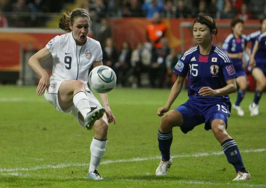 U.S. defender Heather O'Reilly, kicks the ball past Japan's Aya Sameshima. Photo: Michael Probst, Associated Press