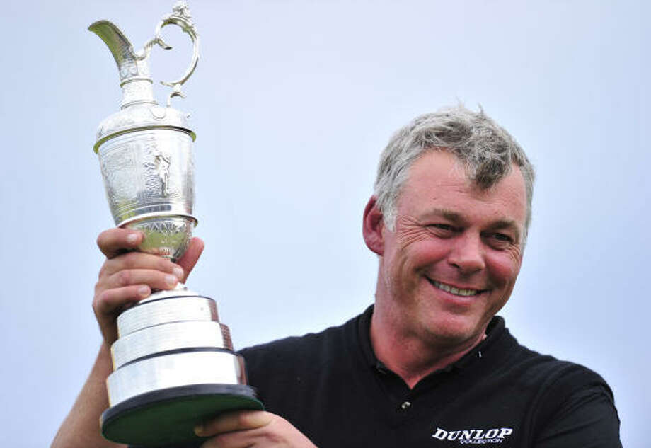 July 17: Final roundDarren Clarke shows off the Claret Jug after winning the 140th British Open. Photo: GLYN KIRK, Getty