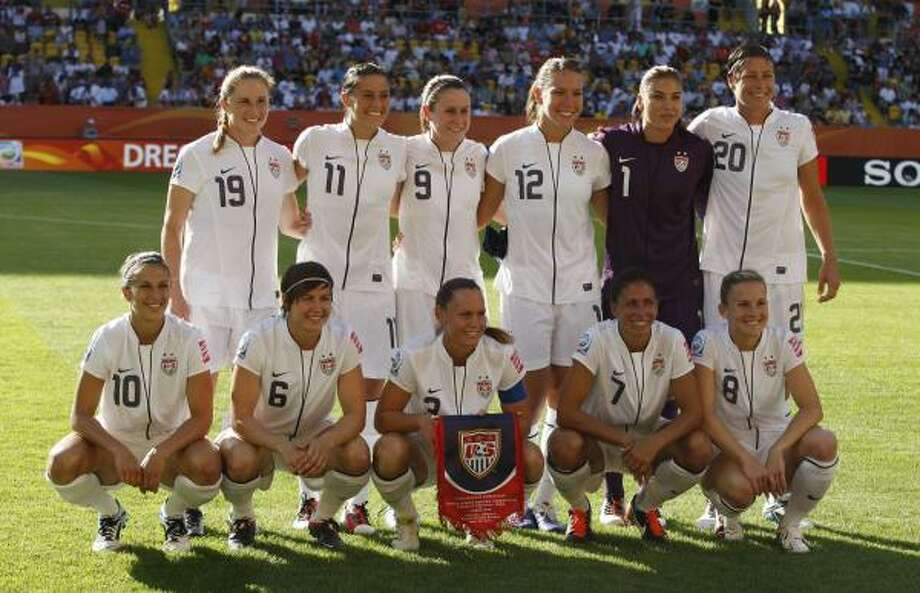 The starting 11 for the U.S. women's soccer team pose for a photo before a Group C match against North Korea. The players are (from top left and from bottom left) Rachel Buehler, Alex Krieger, Heather O Reilly, Lauren Cheney, Hope Solo, Abby Wabach, Carli Lloyd, Amy Le Peilbet, Christie Rampone, Shannon Boxx and Amy Rodriguez. Photo: Petr David Josek, Associated Press