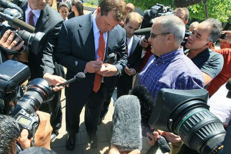 July 14, 2011 Roger Clemens autographs a baseball as leaves the court after the judge declared a mistrial. The judge set a Sept. 2 date for a hearing on whether prosecutors can pursue a second trial under protections against double jeopardy. Photo: Mark Wilson, Getty