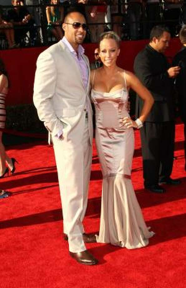 NFL player Hank Baskett and wife TV personality Kendra Wilkinson Photo: Frederick M. Brown, Getty