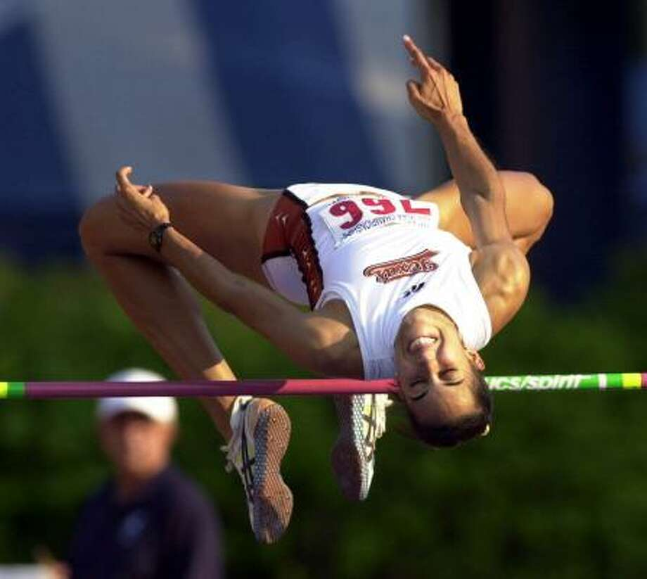 Erin AldrichTexasTwo-sport star won six Big 12 high jump titles (three indoor and outdoor) and four NCAA titles. In volleyball, she was the 1998 freshman of the year and an All-American. Photo: JIM SIGMON, AP