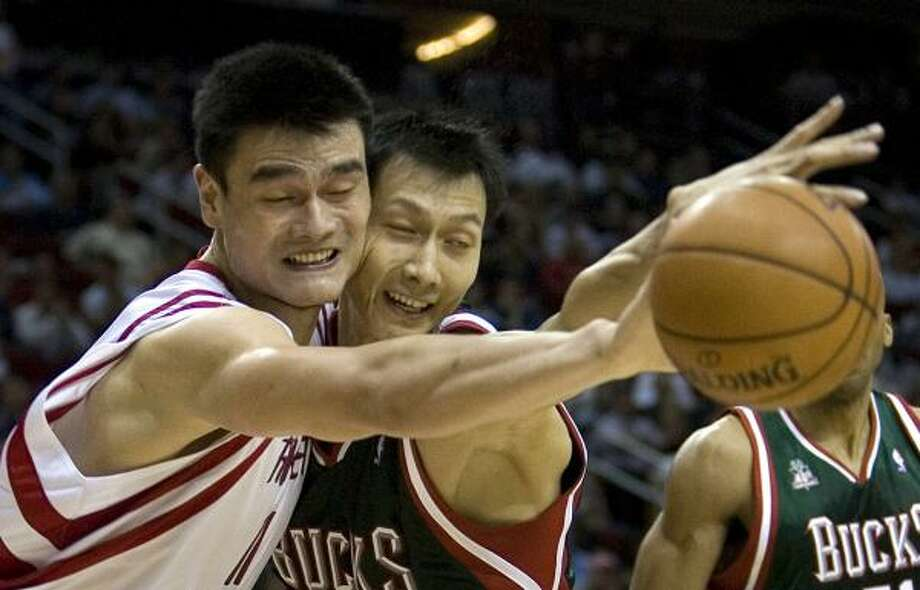 Basketball pioneerYao Ming's success in the NBA led to a greater number of players joining the league from overseas, such as Yi Jianlian of China. Photo: Smiley N. Pool, Chronicle