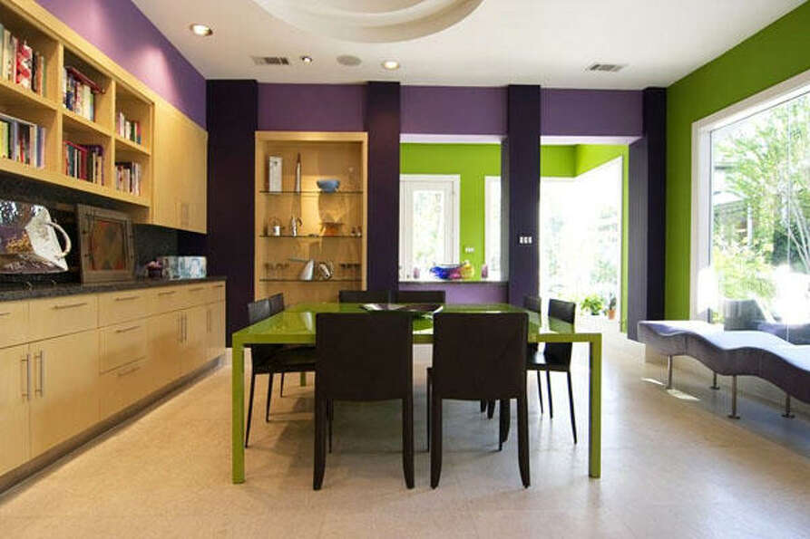 The kitchen, revealing the breakfast area and highlighting the cabinets and shelves.
