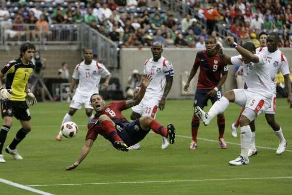 The United States' Clint Dempsey #8 falls to the ground as the United States plays Panama during the CONCACAF Gold Cup 2011 semi-finals at Relaint Stadium Wednesday, June 22, 2011, in Houston.