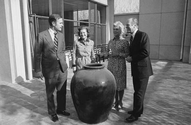 President Ford, right, and first lady Betty Ford, second from left, visit then-Ambassador George H.W. Bush and Bush's wife, Barbara, in 1975 in China. Photo: Associated Press