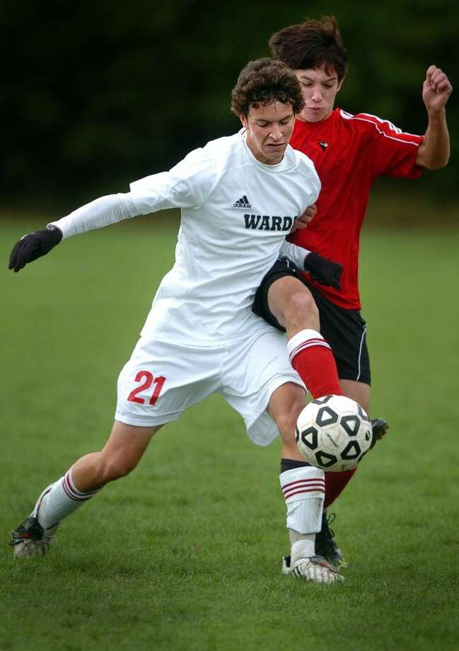Fairfield Warde's Kevin Petroccio struggles with Greenwich's Juliaan Zenner during the first half of Wednesday's match at Warde. Photo: Autumn Driscoll / Connecticut Post