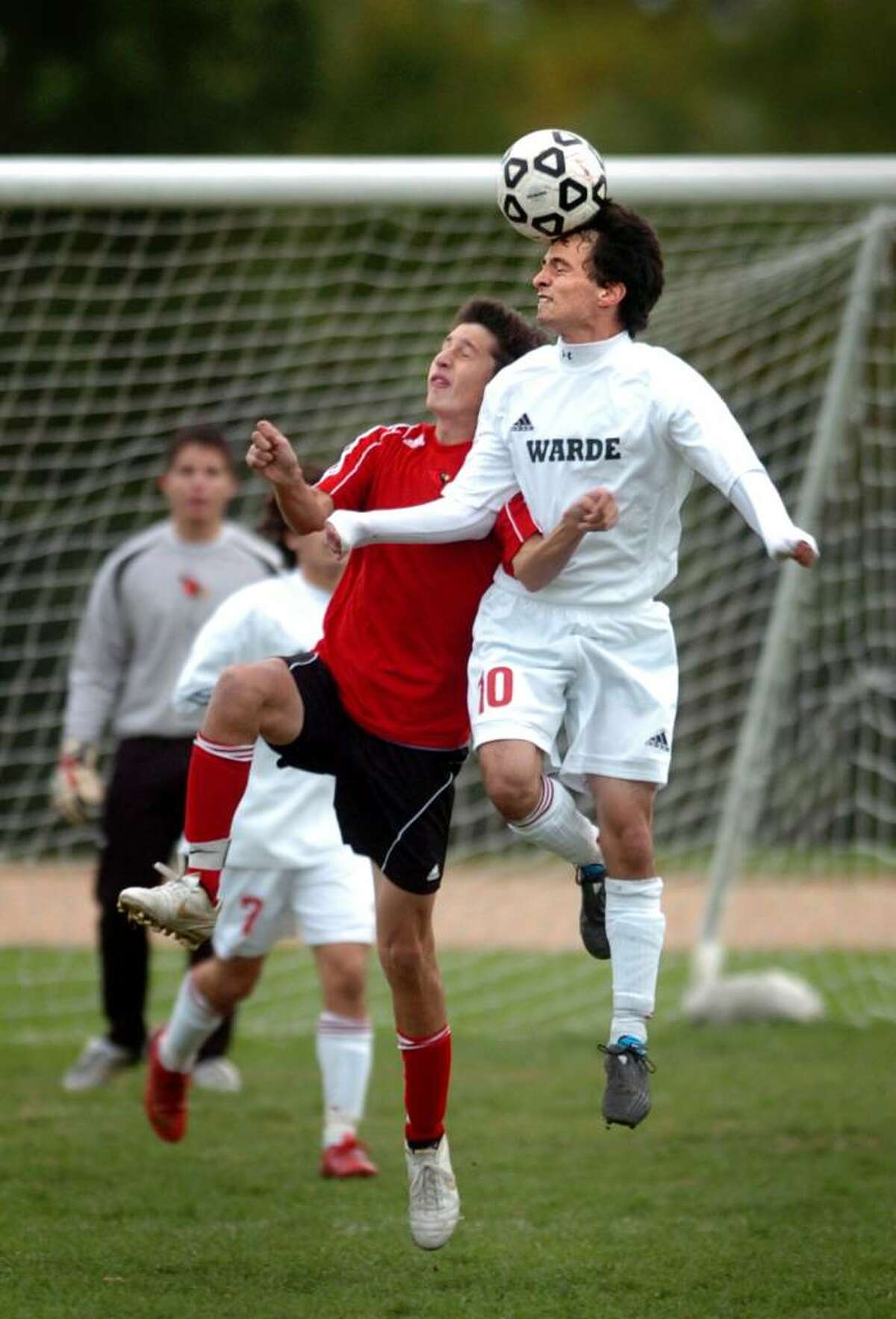 Fairfield Warde's Oliver DeBarros heads the ball as Greenwich defender Tomas Agrest also goes up for the ball during the second half of Wednesday's match at Warde.