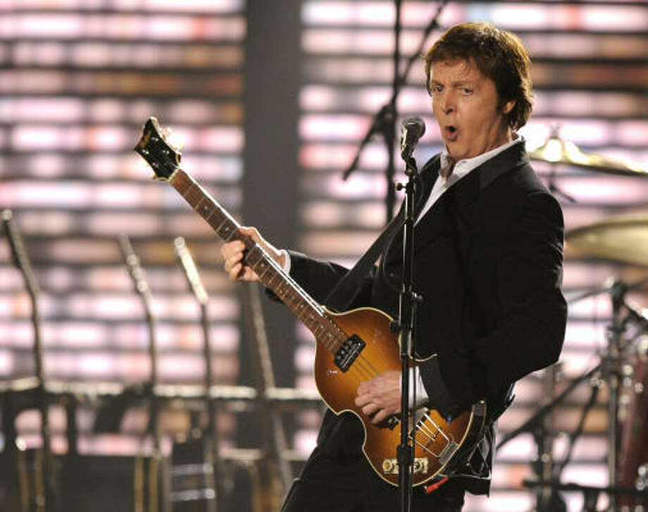 "Sir Paul McCartney: ""I was on my way back to England, and we were at JFK on the tarmac, and the pilot just suddenly said, 'We can't take off. We're going to have to go back to base.'"" Photo: Mark J. Terrill, AP"