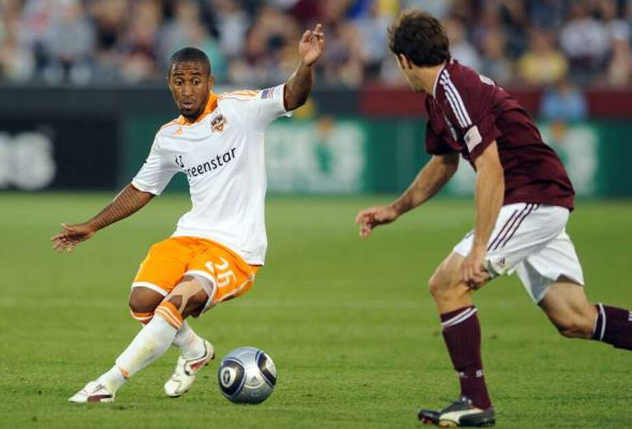July 3: Dynamo 0, Colorado 0 Corey Ashe of the Dynamo controls the ball against the Colorado Rapids' defense. Photo: Bart Young, Getty
