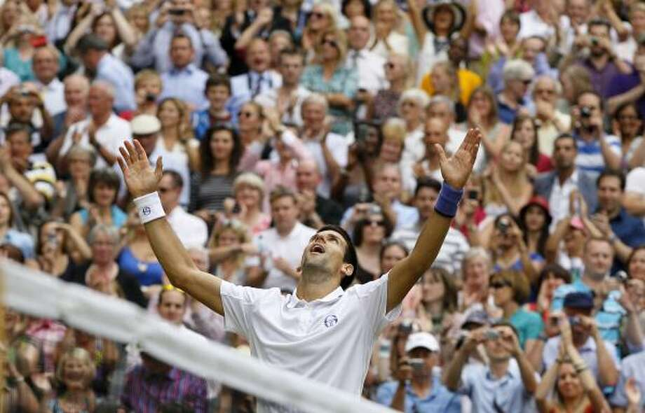 July 3 Novak Djokovic celebrates after defeating Rafael Nadal. Photo: Kirsty Wigglesworth, Associated Press