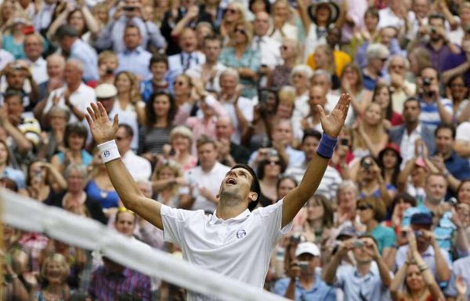 July 3Novak Djokovic celebrates after defeating Rafael Nadal. Photo: Kirsty Wigglesworth, Associated Press