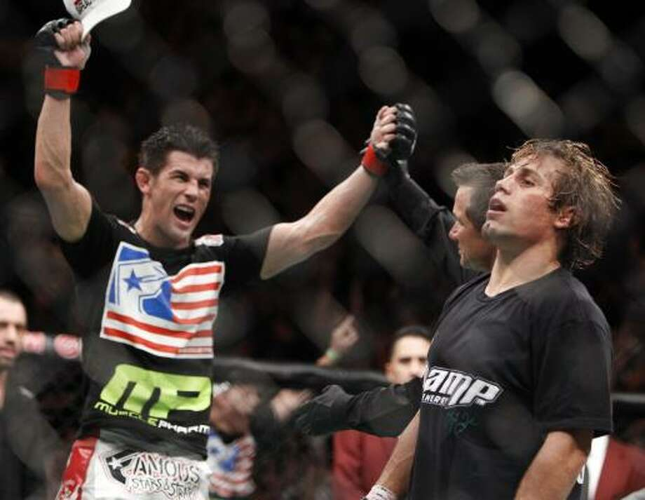 Dominick Cruz, left, celebrates his victory over Urijah Faber, right, shortly after their UFC 132 bantamweight title match Saturday at The MGM Grand Garden Arena in Las Vegas. Cruz won by unanimous decision. Photo: Eric Jamison, Associated Press