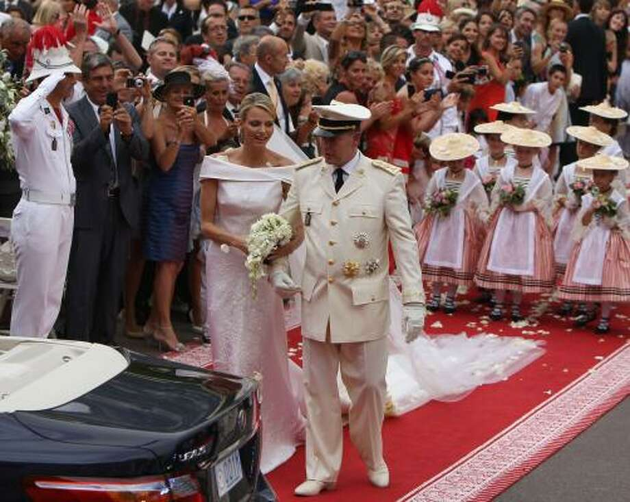 Princess Charlene and Prince Albert II leave their star-studded ceremony in Monaco. The Roman Catholic event followed Friday's civil wedding. Photo: Dan Kitwood, Getty
