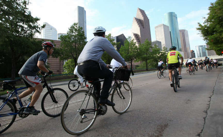Critical Mass bike riders take to the streets in this June 28, 2011 file photo. Photo: Mayra Beltran, Houston Chronicle