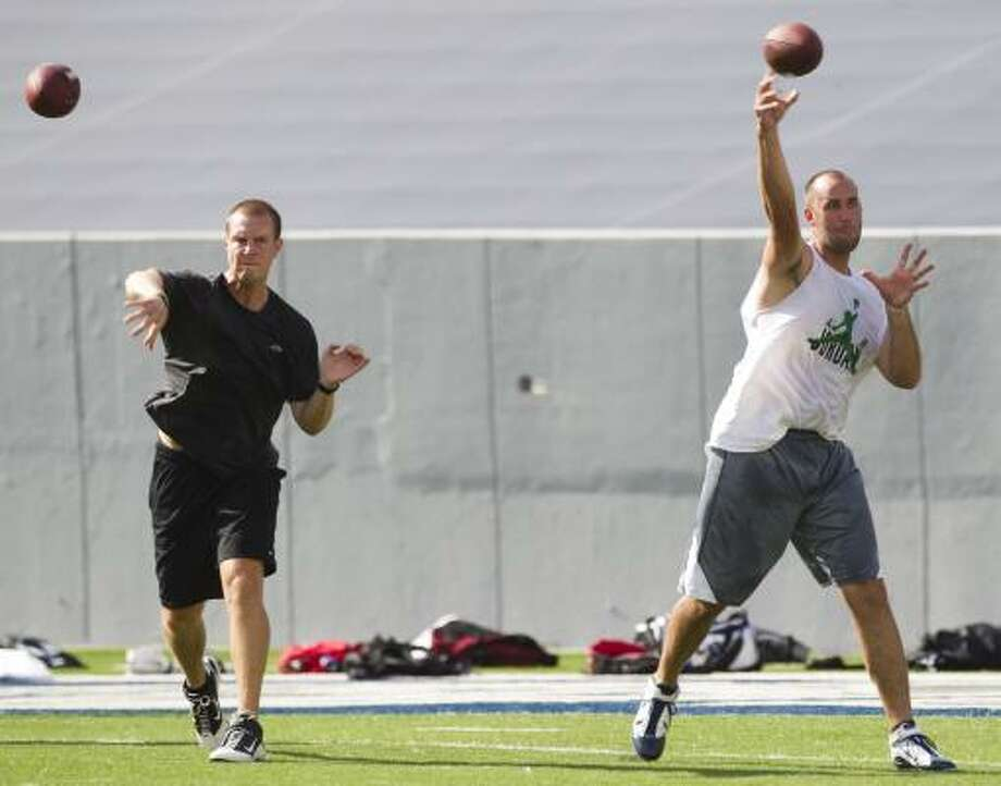 Texans draft pick quarterback T.J. Yates, left, and Matt Schaub warm up passes with a few throws. Photo: Brett Coomer, Chronicle