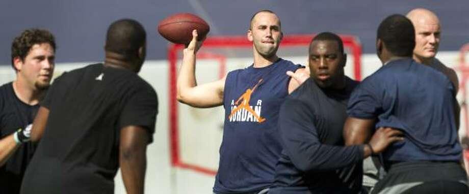 Texans quarterback Matt Schaub, center, scans the field for an open receiver. Photo: Brett Coomer,  Chronicle