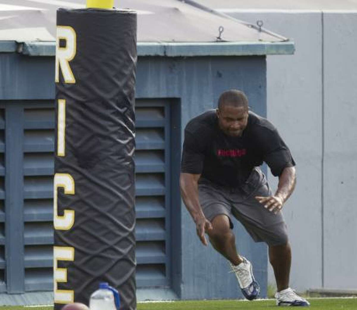 Texans defensive lineman Amobi Okoye warms up near the endzone.