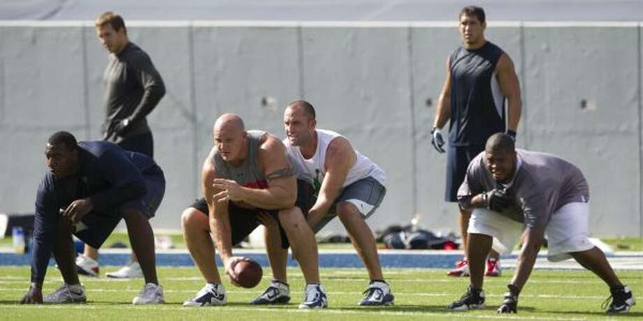 Texans quarterback Matt Schaub takes a snap from center Chris Myers. Photo: Brett Coomer, Chronicle