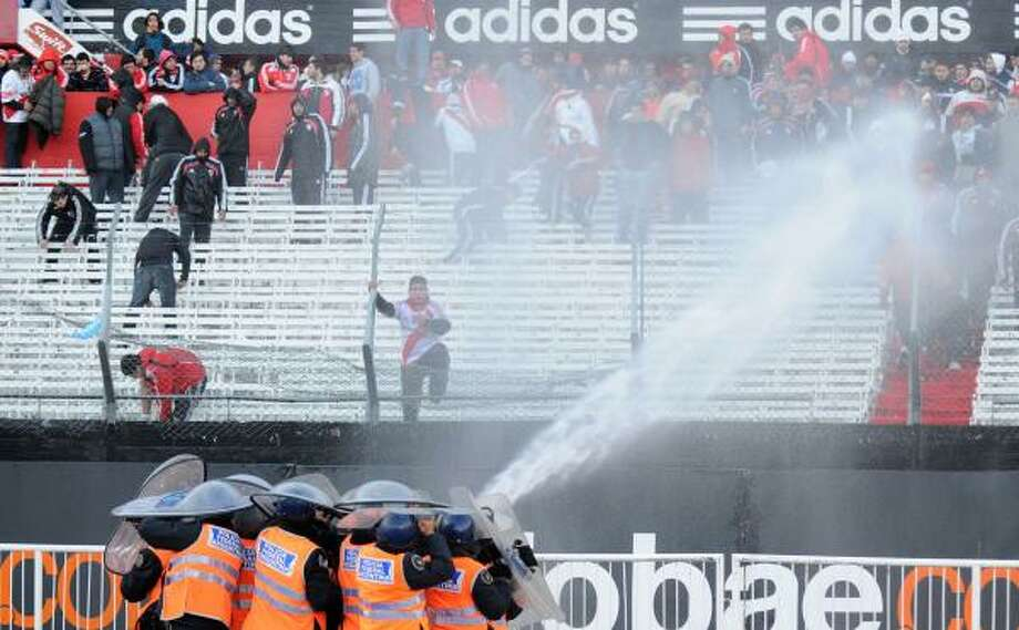 Police use fire hoses to try to control angry River Plate fans after the storied Argentine club was relegated to the second division for the first time in its 110-year history. For American sports fans, it's the equivalent of the Boston Red Sox being sent down to Triple A or the Celtics playing in the D-League. Photo: JUAN VARGAS, Getty