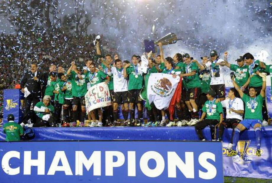 June 25: Gold Cup FinalMexico 4, U.S. 2Mexico's players celebrate after winning the CONCACAF 2011 Gold Cup final match 4-2 against the United States. Photo: GABRIEL BOUYS, Getty