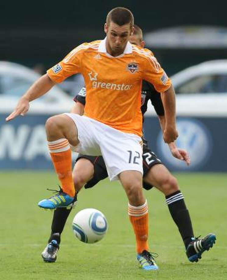 Houston Dynamo forward Will Bruin (12) controls the ball against D.C. United defender Perry Kitchen (23) during the second-half. Photo: Chuck Myers, McClatchy-Tribune News Service