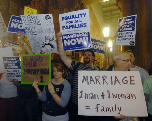 Gay marriage supporters and opponents rally in the hallways at the Capitol in Albany. Photo: Hans Pennink, Associated Press