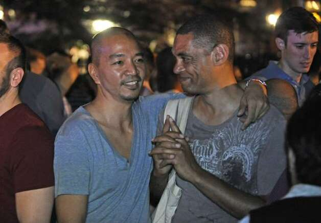 Couple of 22 years Angelo Ragaza, left, and Bryan Webster celebrate in Manhattan's west village following the passing of the same sex marriage bill. Photo: Louis Lanzano, Associated Press