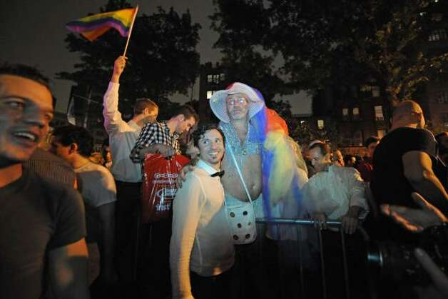 Revelers celebrate in Manhattan's west village. Photo: Louis Lanzano, Associated Press
