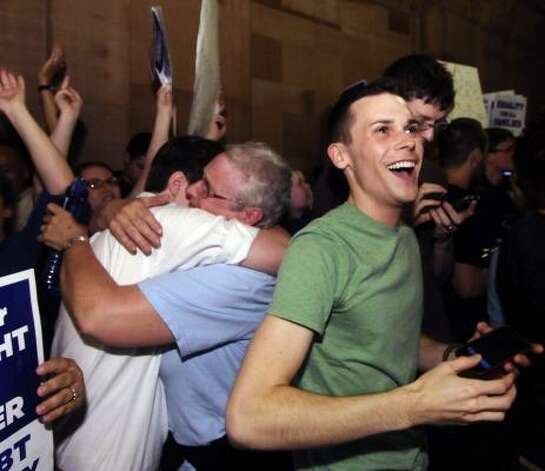 Supporters of same sex-marriage celebrate after Senate members voted and approved the same-sex marriage bill 33-29 during a session of the New York state Senate at the Capitol in Albany, N.Y. Photo: Hans Pennink, Associated Press