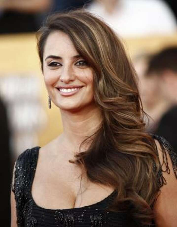 "Penelope Cruz said she can no longer hold her alcohol after abandoning her ""wild, confused"" side. ""Now after two beers...I'm already tipsy. I guess I'm what men would call a cheap date!"" Photo: Matt Sayles, AP"