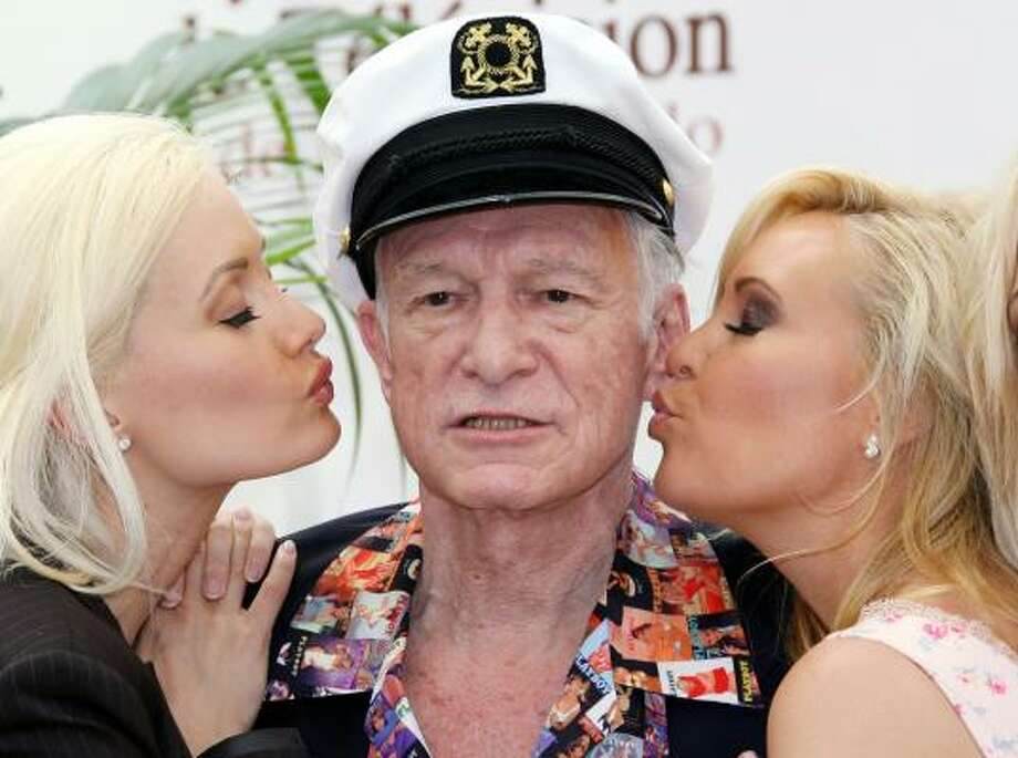 """Hugh HefnerThe """"runaway bride-themed"""" special will air in July and feature former Girls Next Door Holly and Kendra consoling the heartbroken Playboy founder, according to Hef's Twitter account. Photo: VALERY HACHE, AFP/Getty Images"""