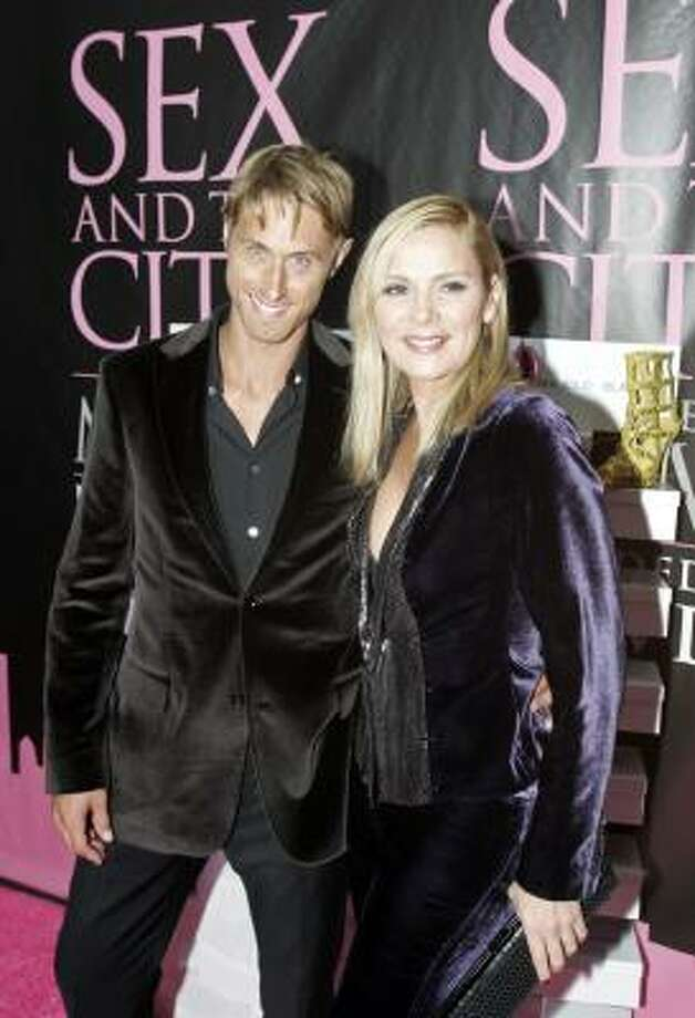 Kim Cattrall, right, and boyfriend Alan Wyse arrive for the DVD launch event for Sex and the City: The Movie - Extended Cut, in New York City Thursday Sept. 18, 2008. Photo: David Goldman, AP
