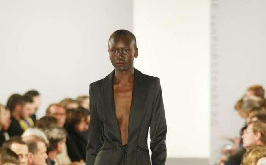 Model Alek Wek rocks the catwalk with this razor-edge look Photo: LUDWIG BONNET, Abaca