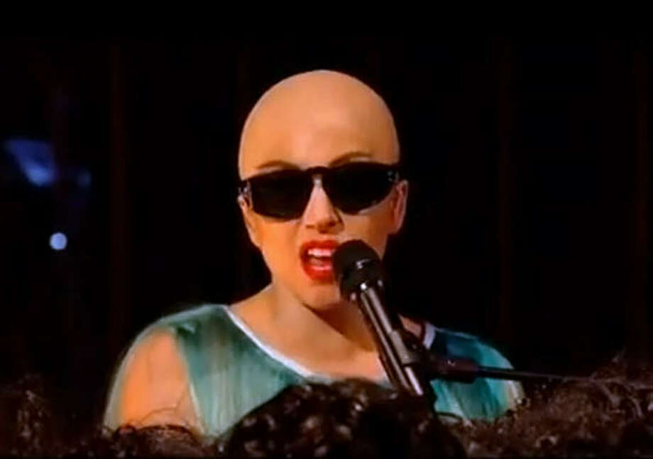 Lady Gagawears a bald cap on the UK's Paul O'Grady Show to her song 'Hair'. Photo: AP