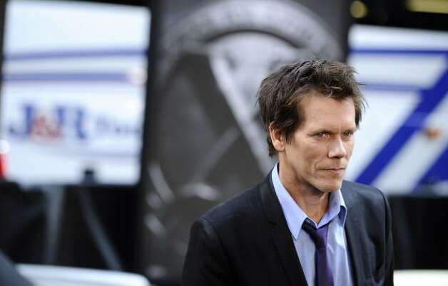 "Kevin Bacon listed several resolutions for his fans, including the following: ""Tell my kids that I love them all the time (but think carefully about getting another family tattoo).""  Photo: Peter Kramer, Associated Press"