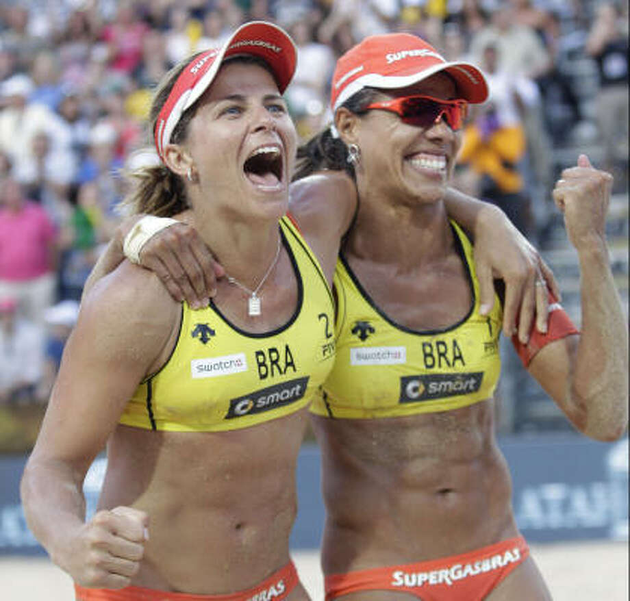 Brazil's Larissa Franca, left, and Juliana Silva celebrate after beating the U.S. to win the women's beach volleyball title. Photo: Pier Paolo Cito, Associated Press