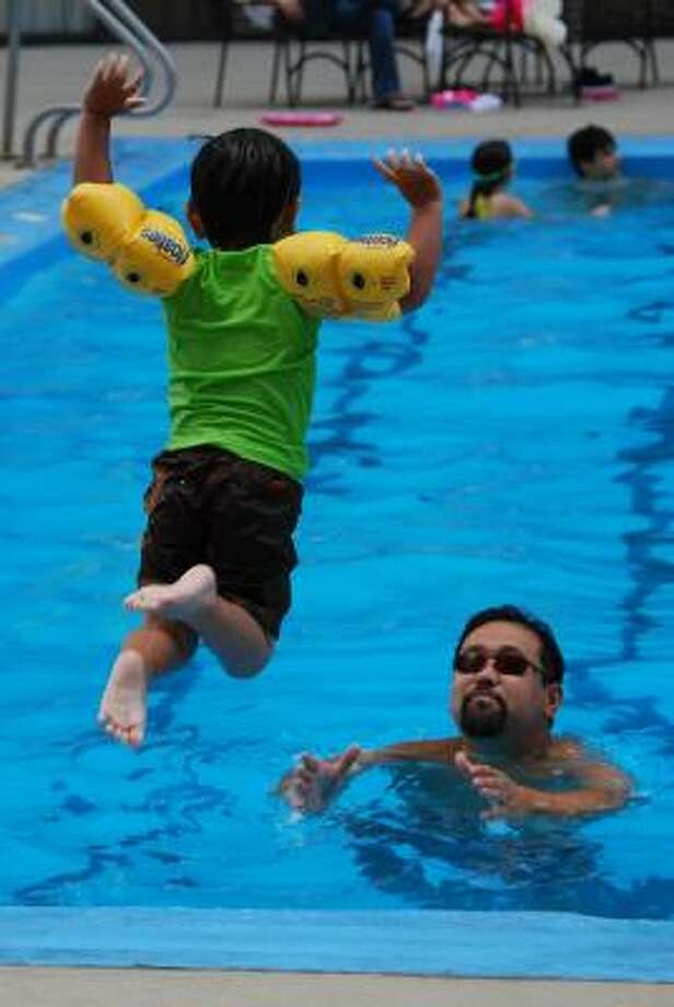 "My husband, Satoshi, is the best. man. ever. Not only that-- he is the BEST father in the world. He lives to be a dad and is always there to catch us when we fall-- or jump! (see pic).  He plans fun weekends for our family and is supportive and involved in all things family! We met while I was teaching English in Japan over 10 years ago. English is his second language-- and he has made it his mission to make sure our son learns the Japanese culture and that he learns to speak the language as well. Aidan, our 4 year old son has ""read"" over 7,000 books in Japanese! Translation: my husband has made it a priority to go to the library regularly and to read (and track) these books to my son. My son LOVES books and thanks to his father, will have the gift of literacy in more than one language!"